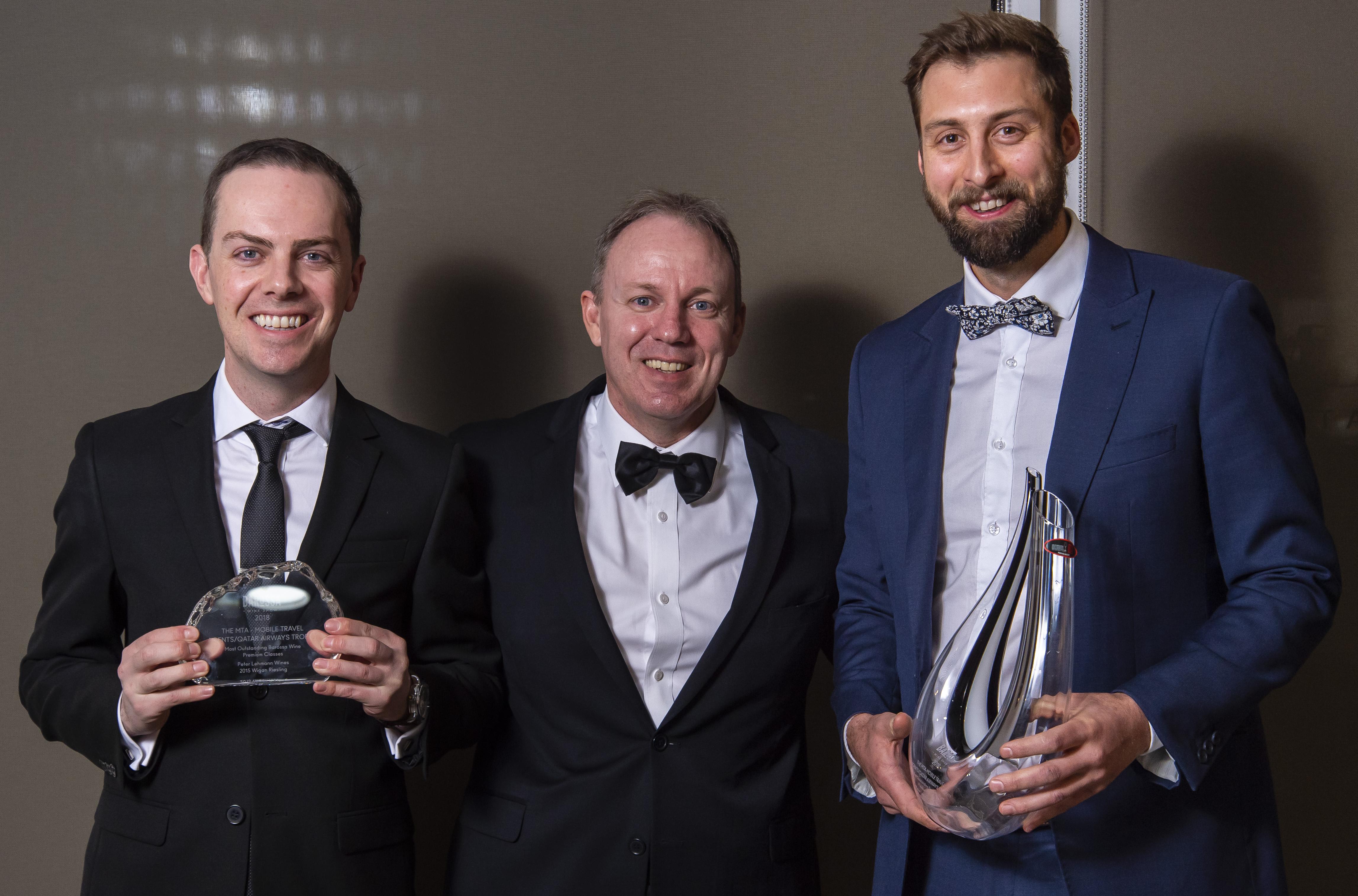 Steven Eikhoff and Aaron Sard (MTA & Qatar Airways) present Tim Dolan with the MTA- Mobile Travel Agents / Qatar Airways Trophy, Most Outstanding Barossa Wine, Premium Classes, Barossa Wine Show 2018