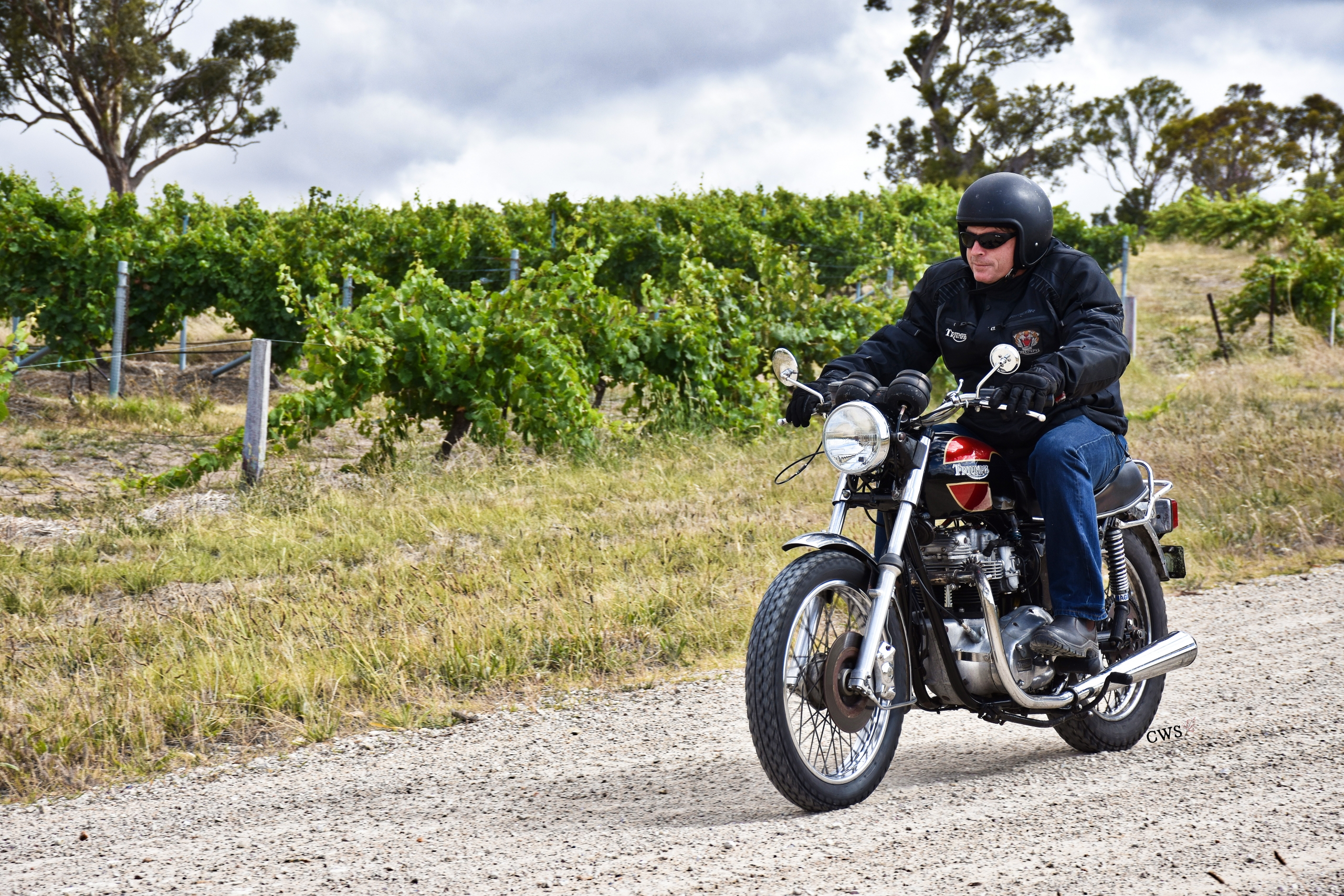Tim Smith rides his Triumph motorcycle