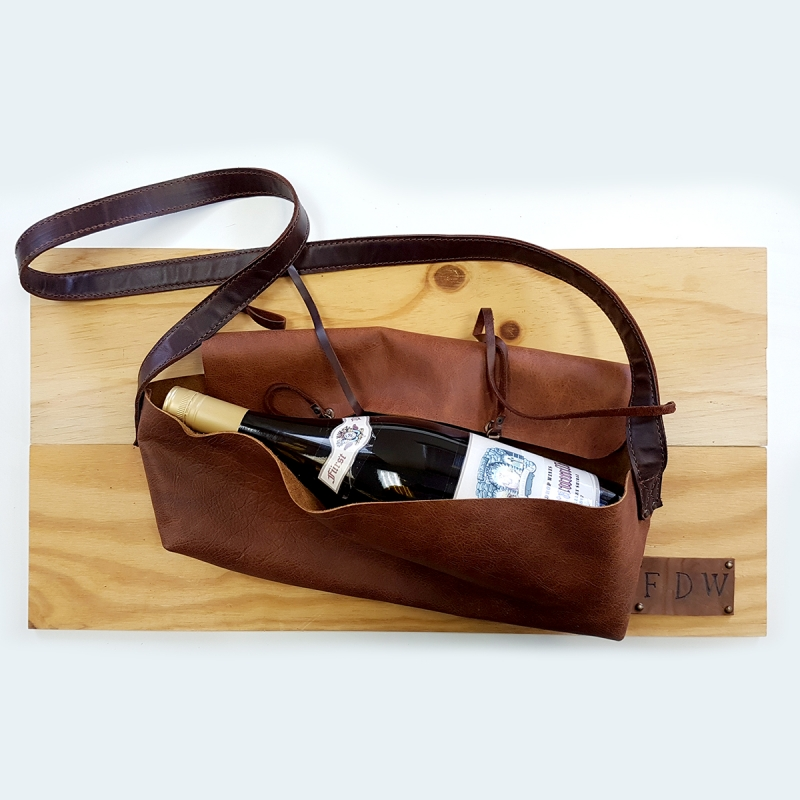 Handcrafted leather saddle bag containing a magnum of Barossa Shiraz